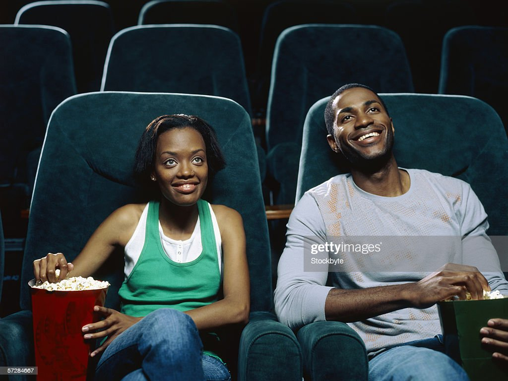 Young couple watching movie in a movie theatre : Stock Photo