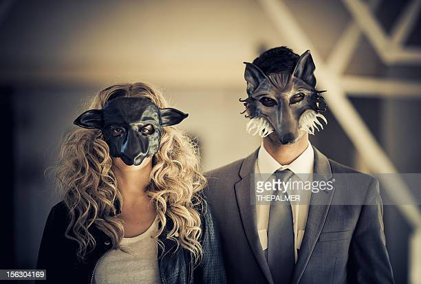 young couple wearing animal mask