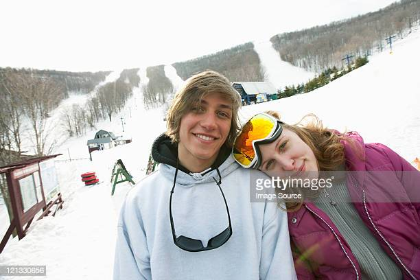 young couple wearing winter sports clothing, portrait - roxbury massachusetts stock pictures, royalty-free photos & images