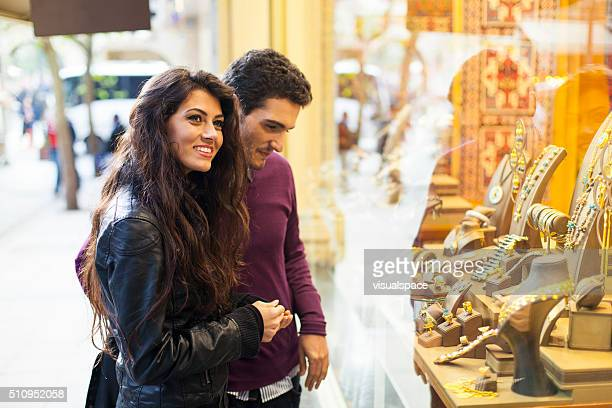 Young Couple Window Shopping at a Jewelry Shop