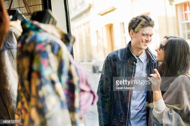 young couple window shopping - sean malyon stock pictures, royalty-free photos & images