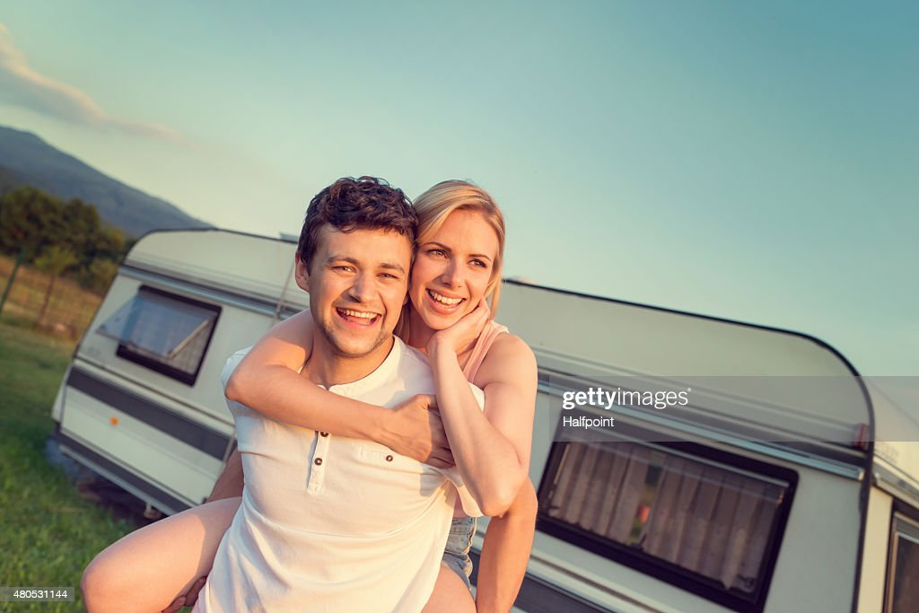 Young couple with a camper van : Bildbanksbilder