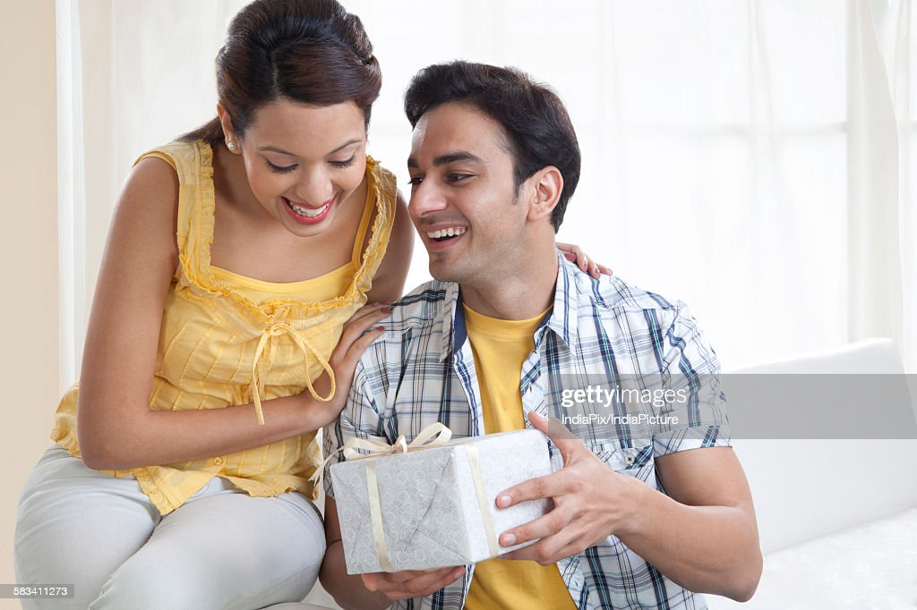 Young couple with a gift box : Stock Photo