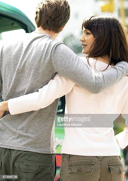 Young couple with arms around each other