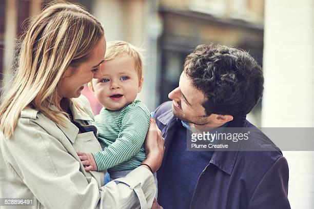 young couple with baby - family with one child stock pictures, royalty-free photos & images