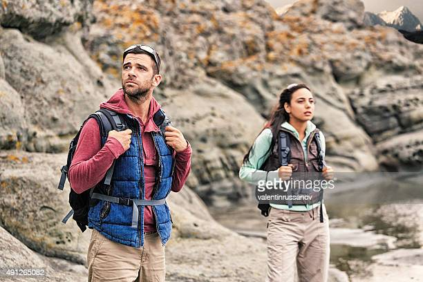Young couple with backpacks enjoying