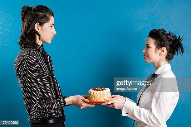 Young couple with cake