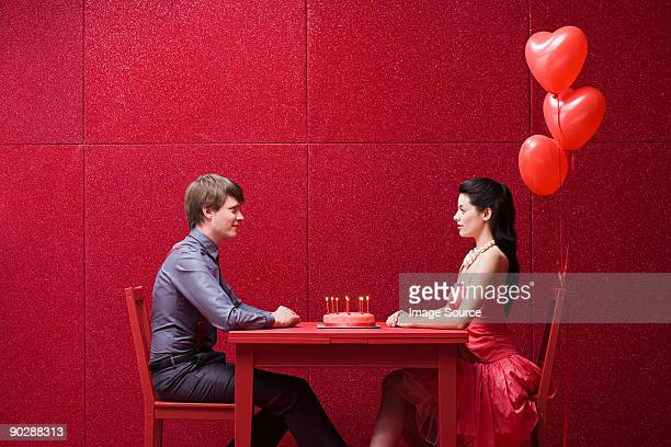 young couple with cake - valentine's day stock photos and pictures