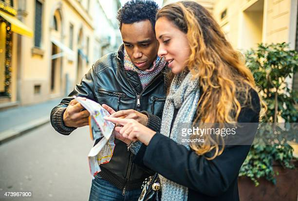 Young couple with city map lost in Milan