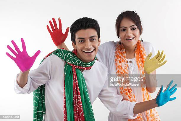 young couple with coloured palms - new generation stock pictures, royalty-free photos & images