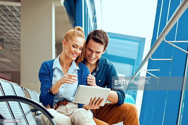Young couple with digital tablet at the airport