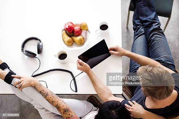 Young Couple With Digital Tablet Browsing