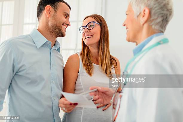 young couple with doctor in a consultation. - human fertility stock pictures, royalty-free photos & images