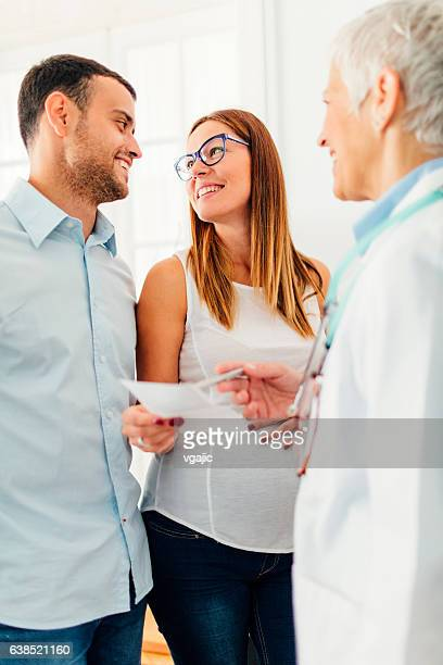 Young Couple with Doctor In A Consultation.