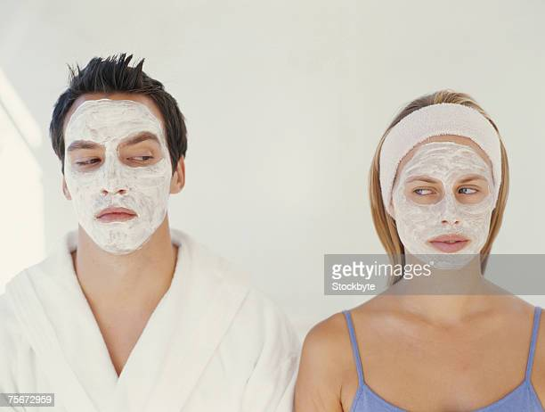Young couple with face mask, close-up