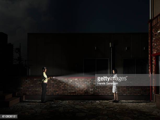 young couple with flashlights