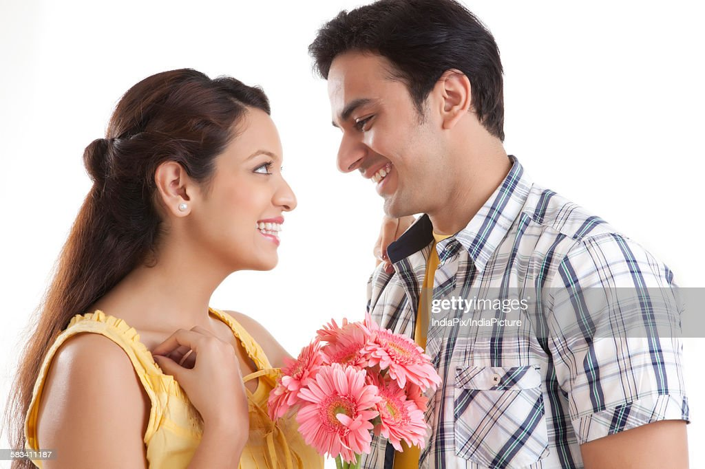 Young couple with flowers : Stock Photo