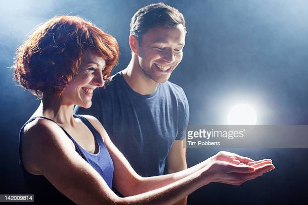 Young couple with glowing light.