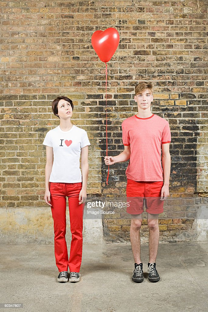 Young couple with heart shaped balloon : Stock Photo