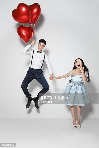 Young couple with heart-shaped balloon