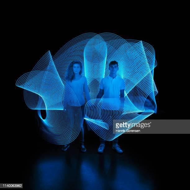 young couple with lighttrace - interaktivität stock-fotos und bilder
