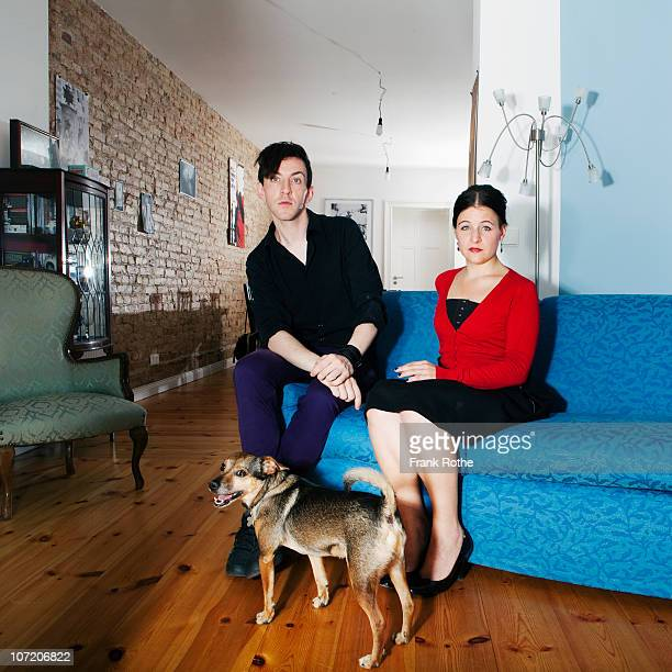 young couple with little dog in beautiful flat