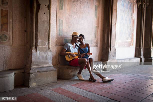 Young couple with mandolin in Bethesda Terrace arcade, Central Park, New York City, USA
