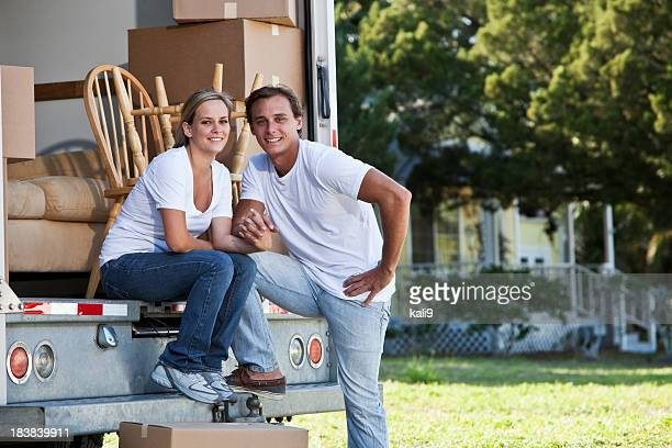 Young couple with moving van