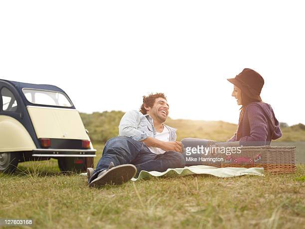 Young couple with picnic basket