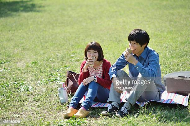Young couple with picnic in field