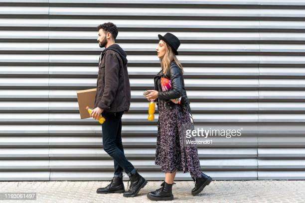 young couple with purchases in the city - white boot stock pictures, royalty-free photos & images