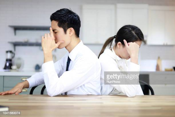 young couple with relationship difficulties ignoring each other - 対立 ストックフォトと画像