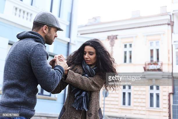 Young couple with relationship problems on street