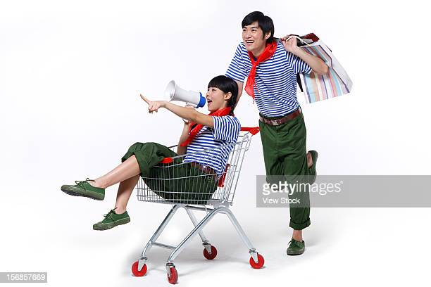 Young couple with shopping cart