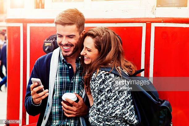 Young couple with smart phone in Istanbul.
