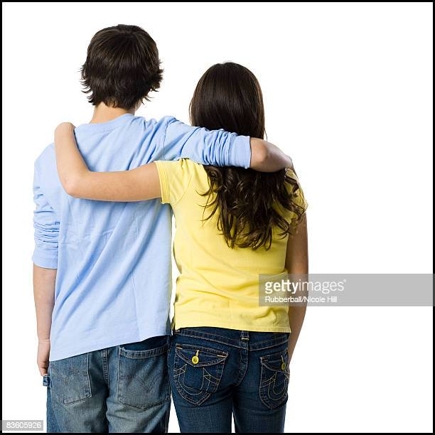 young couple with their arms around one another