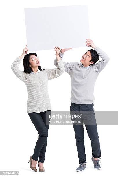 Young couple with whiteboard