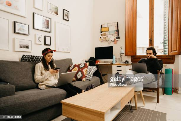 young couple working from home - roommate stock pictures, royalty-free photos & images