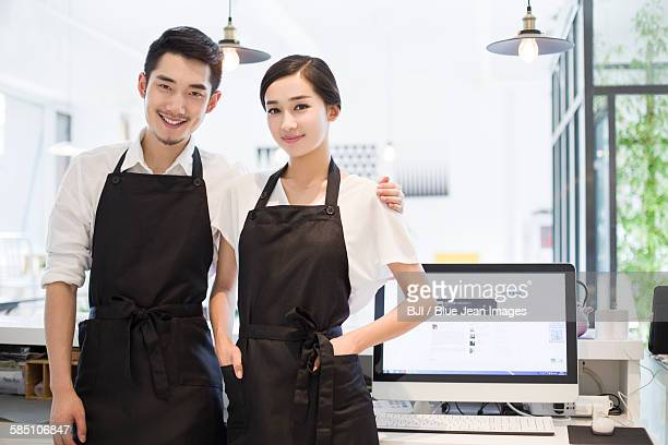 Young couple working in coffee shop