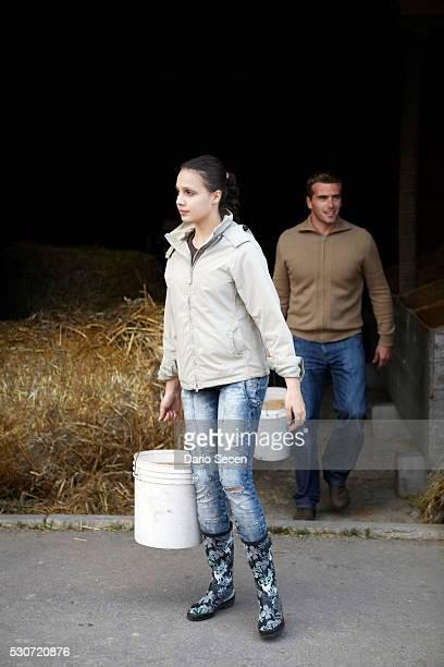 Young Couple Working On Farm, Croatia, Euope