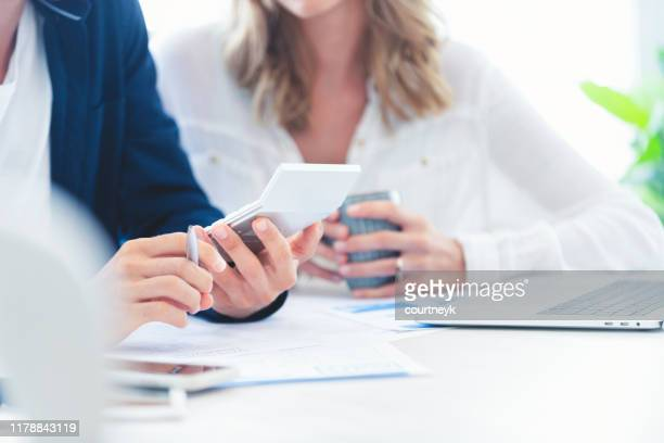 young couple working on their home finances. - economy stock pictures, royalty-free photos & images