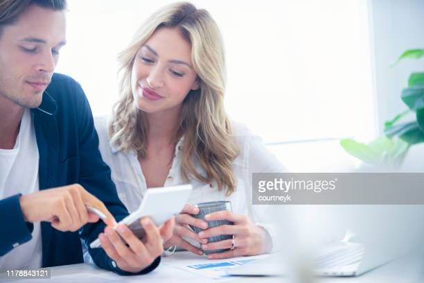 young couple working on their home finances. - commercial activity stock pictures, royalty-free photos & images