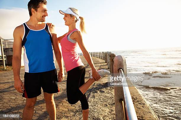 Young couple working out on a pier