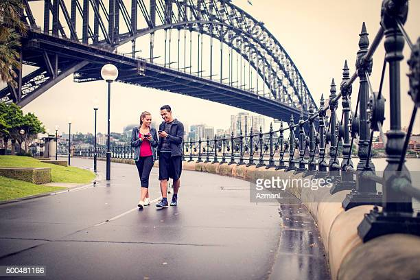 Young couple working out on city street