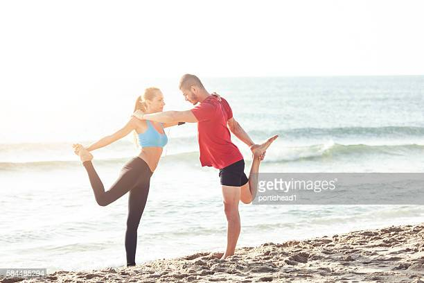 Young couple workout on the beach