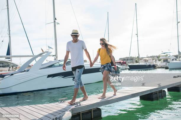 young couple yachting - marina stock photos and pictures