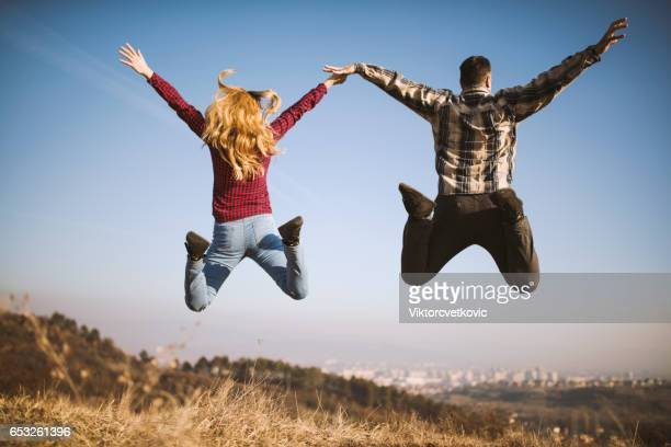 Young couplejumping in the air