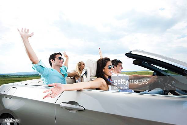 Young couples driving in a cabriolet