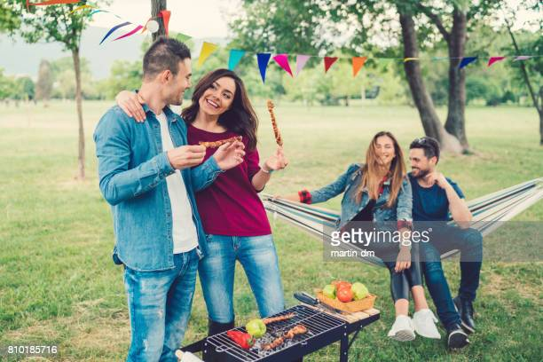 Young couples enjoying barbecue