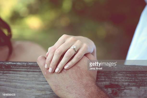 Young Couples' Hands with Engagement Ring